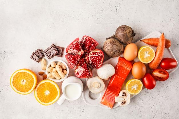 Allergy food concept. allergies to fish, eggs, citrus fruits, chocolate, mushrooms and nuts. Premium Photo