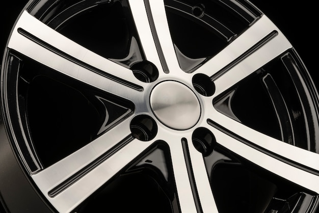 Alloy wheel, black with polishing. side view close-up. empty cover without logo. Premium Photo