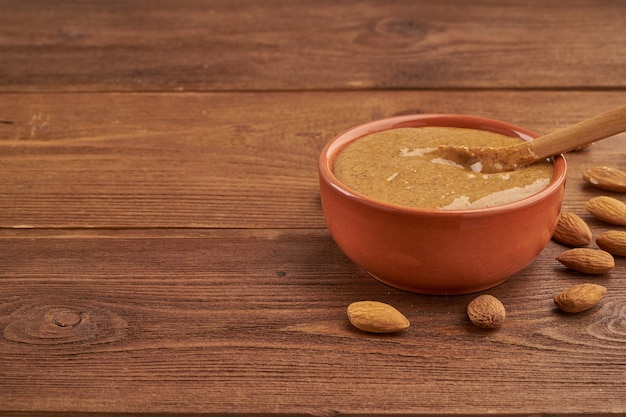 Almond butter, raw food paste made from grinding almonds into a nut butter, crunchy and stir Premium Photo