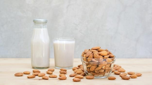 Almond milk on a wooden table. Premium Photo