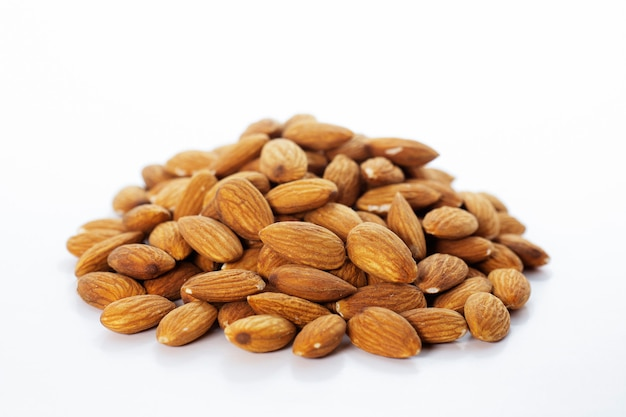 Almond nut on white background. Premium Photo