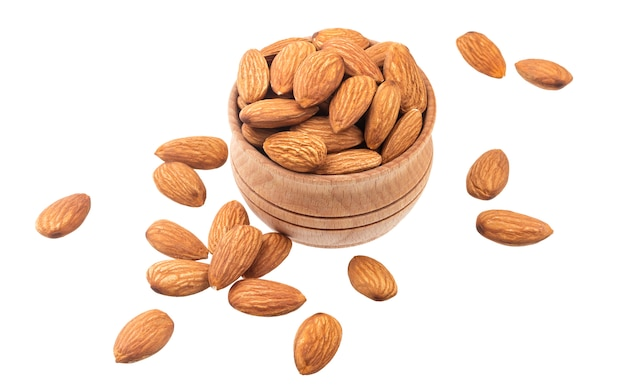 Almond nut in a wooden bowl isolated on white Premium Photo