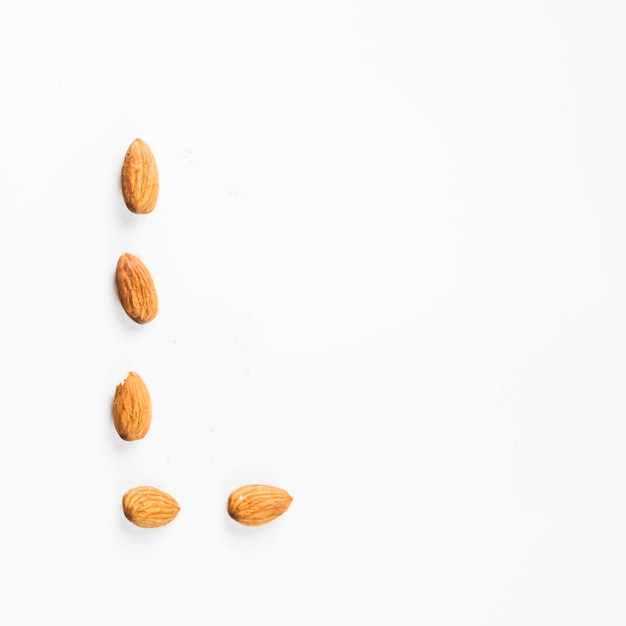 Almond nuts isolated on white backdrop Free Photo
