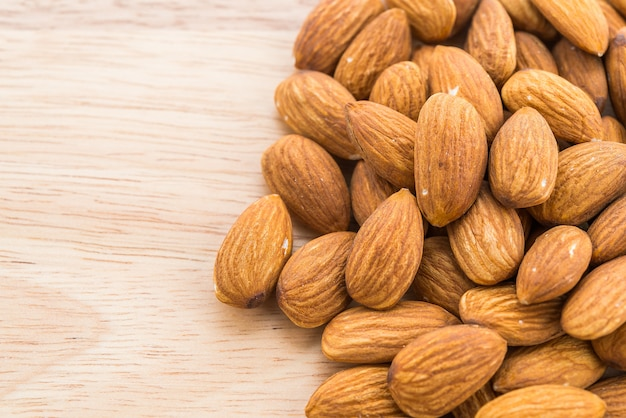 Almond on wooden background Free Photo