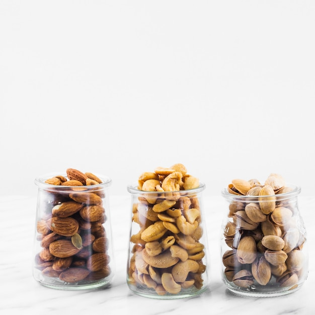 Almonds; cashewnuts and pistachios on marble backdrop Free Photo
