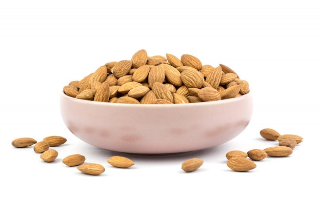 Almonds in pink porcelain bowl Premium Photo