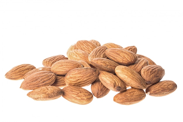 Almonds on white, close up, isolated on white Premium Photo