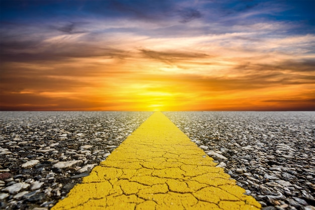 Along the road with sunset sky and sun rays background Premium Photo