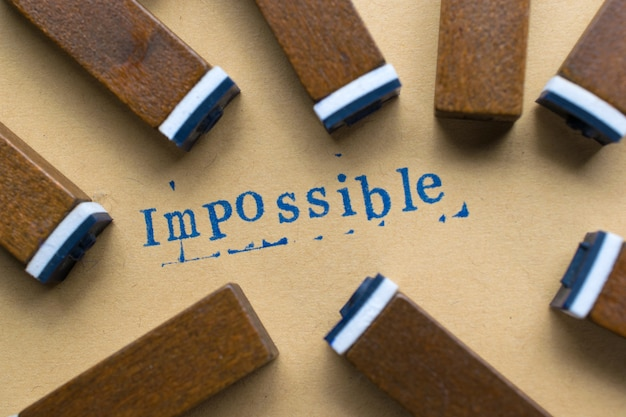 Alphabet letter word impossible from stamp letters font on paper for impossible background Premium Photo