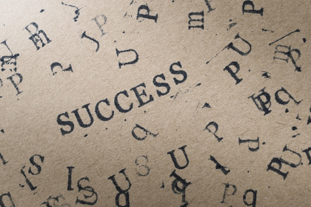 Alphabet letter word success from stamp letters font on paper Premium Photo