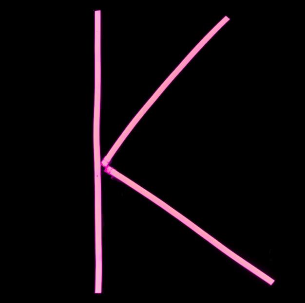 Alphabet pink neon lights on black background Free Photo