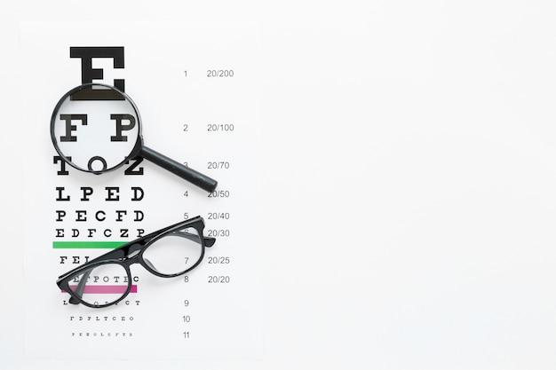 Alphabet table with magnifier and glasses Free Photo