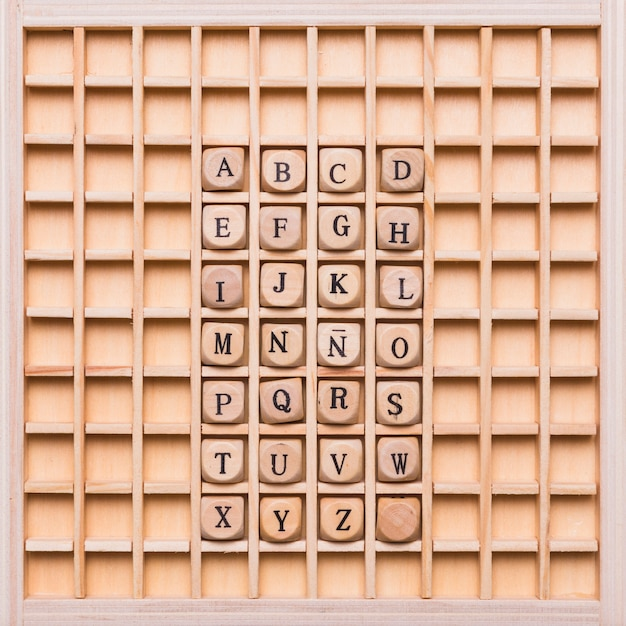 Alphabet with dice on wooden board Free Photo