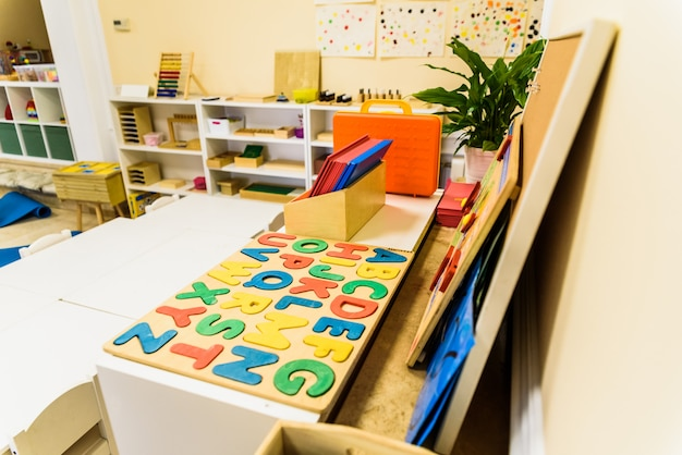 Alphabet with wooden letters in a children's classroom. Premium Photo