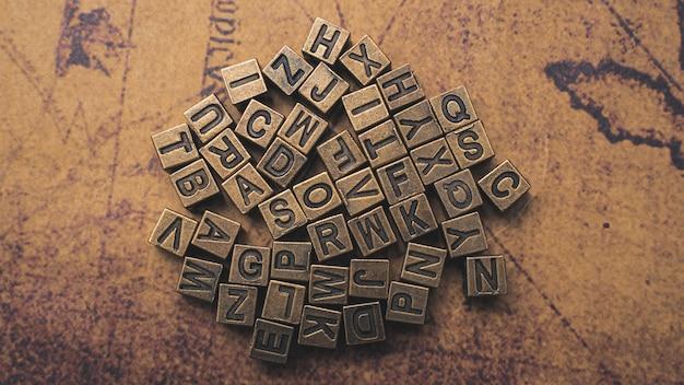 Alphabet on world map Premium Photo