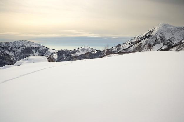 Alpine cloudscape and snow capped mountains Premium Photo