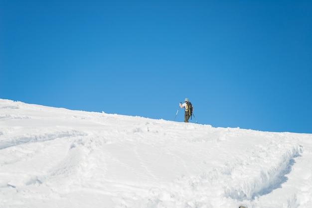 Alpine ski touring towards the summit Premium Photo