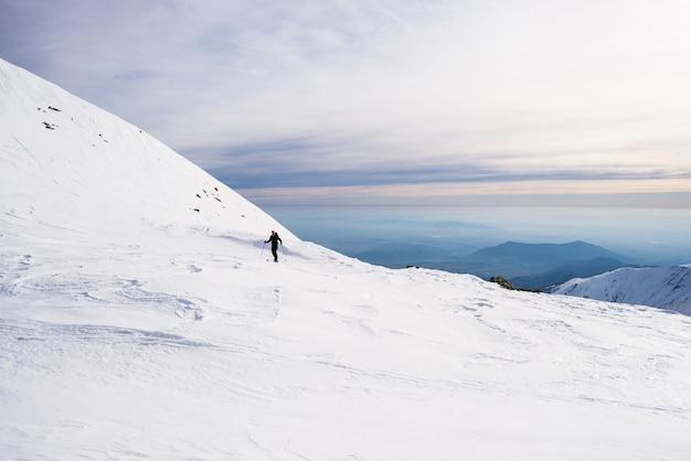 Alpine touring towards the summit Premium Photo