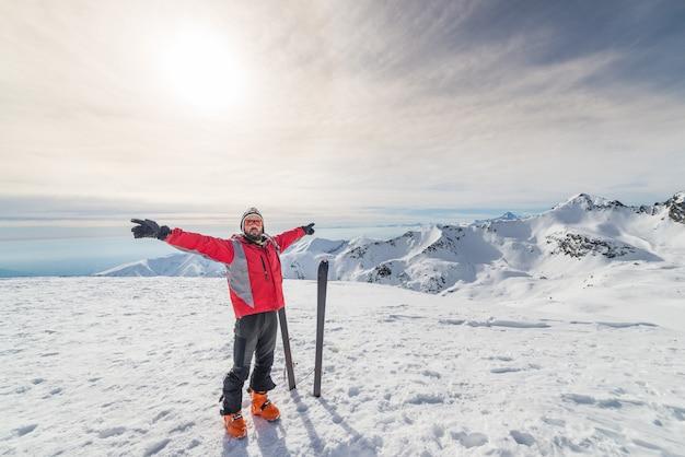 Alpinist with back country ski Premium Photo