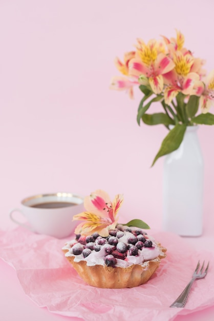 Alstroemeria flower on fruit tart consisting of blueberries Free Photo