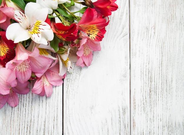 Alstroemeria flowers on a table Premium Photo