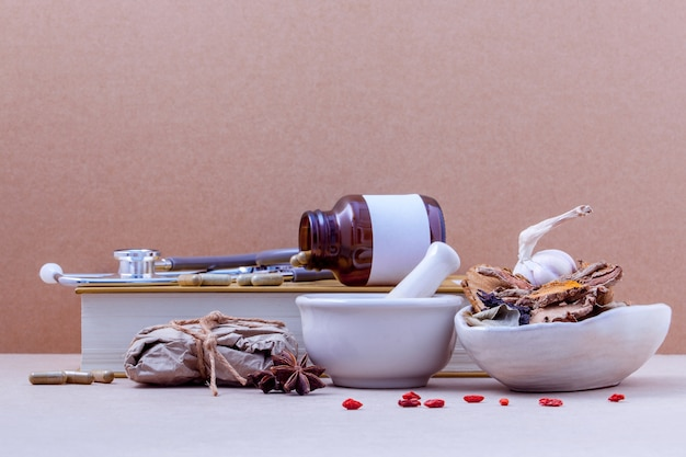 Alternative health care dried various chinese herbs on brown  background. Premium Photo