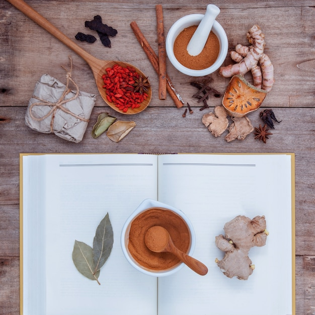 Alternative health care herbs on old wooden background. Premium Photo