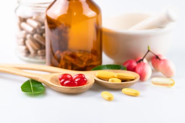 Alternative medicine, pills tablet, capsule and vitamin organic supplements on white background Premium Photo