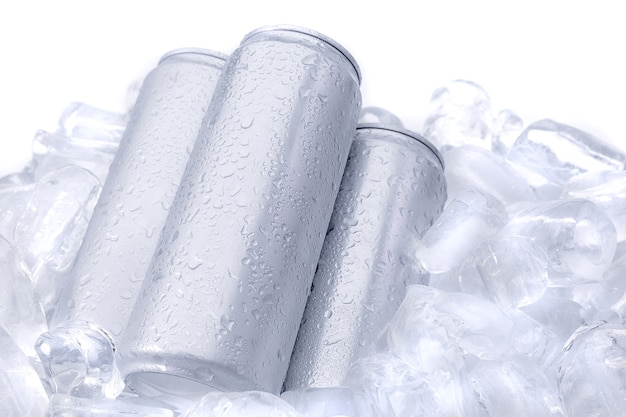 Aluminum beverage drink can on ice isolated on white background Premium Photo