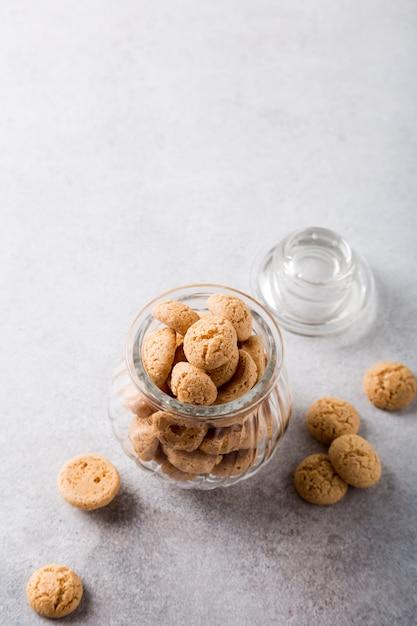 Amaretti cookies in glass pot Premium Photo