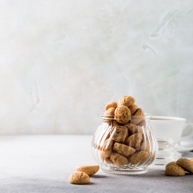 Amaretti cookies with white cup of coffee Premium Photo