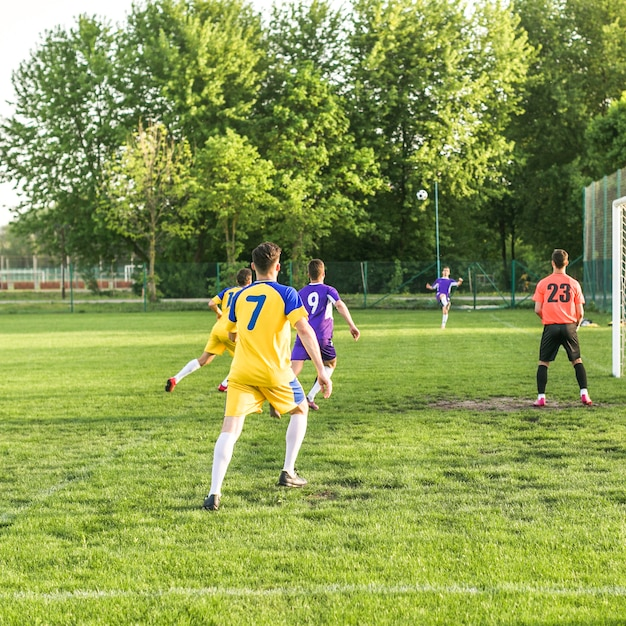 Amateur football concept with match scene Free Photo