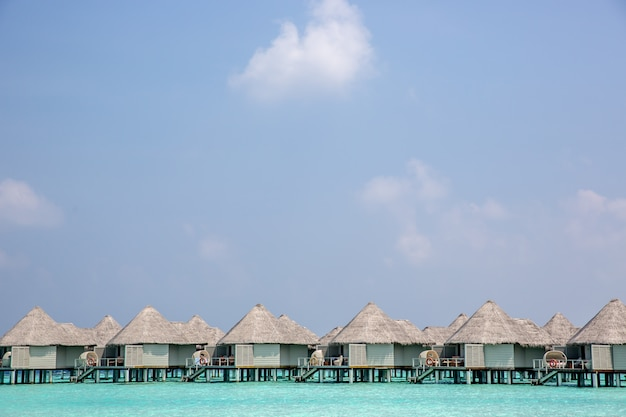 Amazing hotel in paradise with bungalows over the water Premium Photo