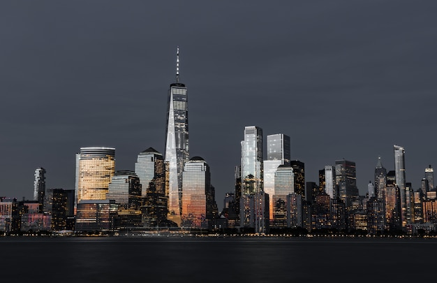 Amazing shot of the high modern skyscrapers of the city skyline at night Free Photo