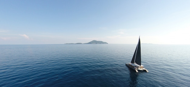 Amazing view to yacht sailing in open sea at windy day. drone view - birds eye angle. - boost up color processing. Premium Photo