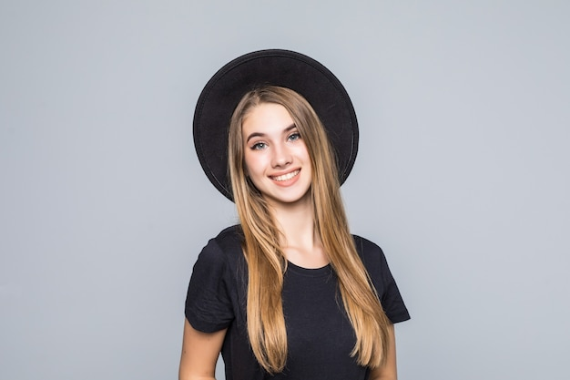 Amazing young with gold hair dressed up in black with retro hat smiles isolated on background Free Photo