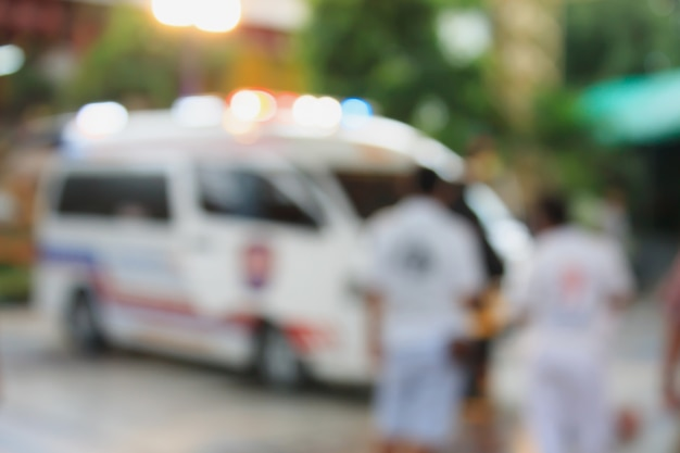 Ambulance responding to an emergency call blurred background Premium Photo