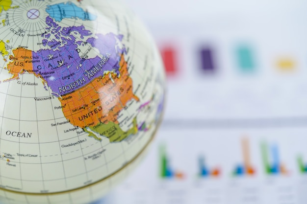 America, globe world map on chart graph paper. finance, account, statistics, investment. Premium Photo