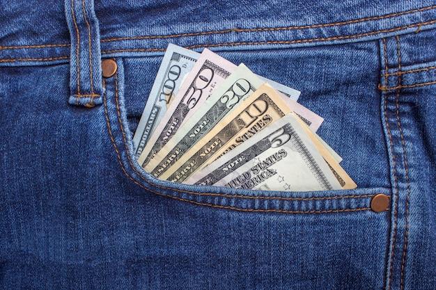 American dollar bills in jeans pocket Premium Photo