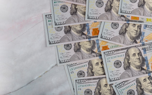 American dollar money in marble background for business Premium Photo