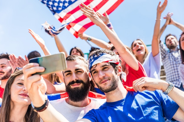American fans taking a selfie at stadium during a match Premium Photo