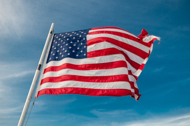 American flag against bright blue sky Premium Photo