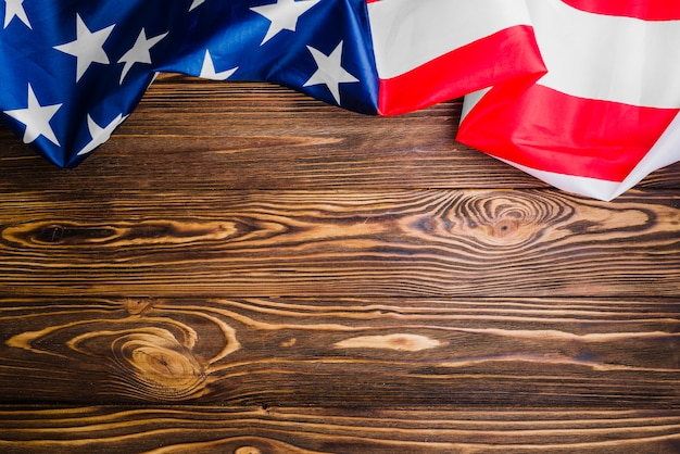 american flag background with copyspace on wooden surface photo