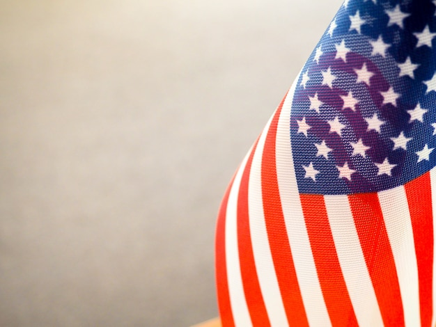American flag on the table, part overexposed and blurry, the independence of america, the great power usa Premium Photo