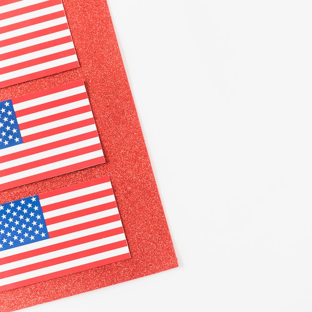 American flags on red velvet Free Photo