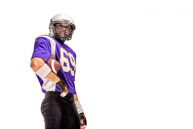 American football player poses in uniform Premium Photo