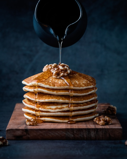 American pancakes or crepes with liquid honey Free Photo