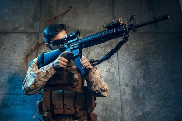 American private military contractor holding rifle. Premium Photo