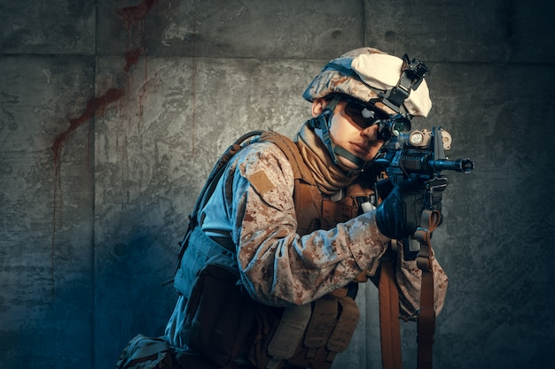American private military contractor shooting a rifle. Premium Photo
