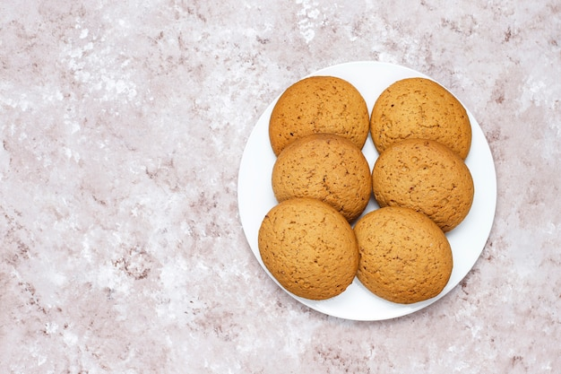 American style peanut butter cookies on light concrete background. Free Photo